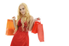 Beautiful blonde woman in lingerie with shopping bag on white ba Stock Images