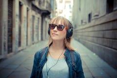 Beautiful blonde woman listening to music Stock Image