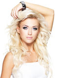 Beautiful blonde woman with long curly hair Stock Photography
