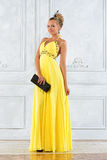 Beautiful blonde woman in a long dress. Royalty Free Stock Image
