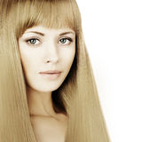 Beautiful blonde woman with long hair and makeup Royalty Free Stock Images