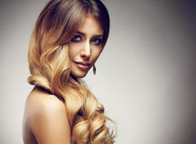 Beautiful blonde woman with long, healthy , straight and shiny hair. royalty free stock photos
