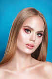 Beautiful blonde woman with long, healthy , straight and shiny hair. Hairstyle loose. Hair. Nude make up Stock Photo