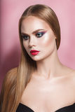 Beautiful blonde woman with long, healthy , straight and shiny hair. Hairstyle loose. Hair. Nude storng colorful make upmake up Royalty Free Stock Photography
