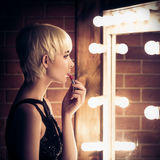 Beautiful Blonde Woman Looking Into A Mirror At Herself Stock Photos