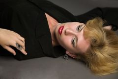 Beautiful blonde woman lying on the floor Royalty Free Stock Photo