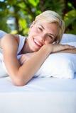 Beautiful blonde woman lying outside Stock Image