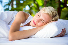 Beautiful blonde woman lying outside Royalty Free Stock Photos