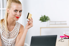 Beautiful blonde woman making shopping via internet Royalty Free Stock Photos