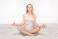 Beautiful blonde woman meditating Stock Image
