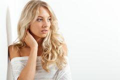 Beautiful blonde woman near white wall Stock Photography