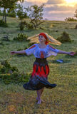 Beautiful blonde woman in old-fashioned dress dancing Stock Photos
