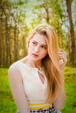 Beautiful blonde woman outdoor. Portrait of a beautiful blonde woman outdoor Royalty Free Stock Image