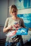 Beautiful blonde woman painter Stock Photo
