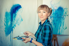 Beautiful blonde woman painter Royalty Free Stock Photos