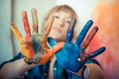 Beautiful blonde woman painter Stock Photography