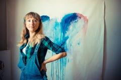 Beautiful blonde woman painter Royalty Free Stock Photo