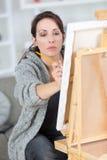 Beautiful blonde woman painter in studio Stock Images