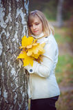 Beautiful blonde woman in park Royalty Free Stock Image