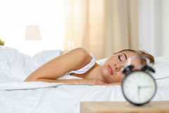 Beautiful blonde woman peacefully lying in bed sleeping Royalty Free Stock Photos