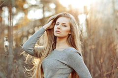 Beautiful blonde woman with perfect long chic hair. Outdoors Royalty Free Stock Photo