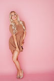 Beautiful blonde woman on pink Stock Images