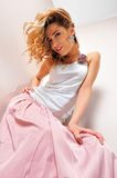 Beautiful blonde woman in pink scirt. stock image