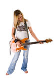 Beautiful blonde woman playing guitar. Full length of a beautiful young blonde woman in jeans playing guitar on white background royalty free stock photos