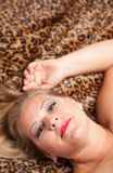 Beautiful Blonde Woman Poses on Leopard Blanket. Stock Photography