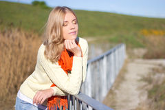 Beautiful blonde woman posing in autumn park Royalty Free Stock Images
