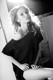 Beautiful blonde woman posing glamorous. Indoor royalty free stock image