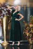 Beautiful Blonde woman posing in green dress Royalty Free Stock Photography