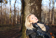 Beautiful blonde woman posing in park Stock Images