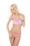 Beautiful blonde woman posing in pink lingerie Stock Image