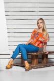 Beautiful blonde woman posing in studio royalty free stock photo