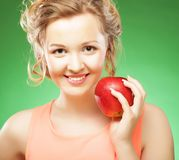 Beautiful  woman with red apple in hand Stock Photos