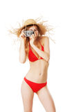 Beautiful blonde woman in red bikini. Taking pictures isolated on white Stock Photography