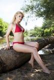 Beautiful blonde woman in red bikini Royalty Free Stock Photography