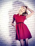 Beautiful blonde woman in red dress. Stock Images