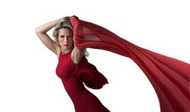 Beautiful blonde woman in red dress, red shawl. A beautiful slim woman let her shawls fly behind her Royalty Free Stock Photos