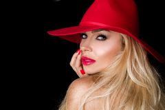 Beautiful blonde woman in a red hat, red jacket suit and  red  tempting lips Stock Photo