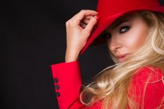 Beautiful blonde woman in a red hat, red jacket suit and  red  tempting lips Stock Photos