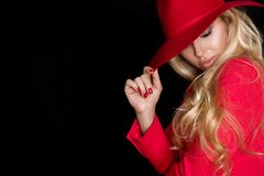 Beautiful blonde woman in a red hat, red jacket suit and  red  tempting lips Stock Photography