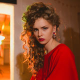 Beautiful blonde woman with red lips and curly Stock Image