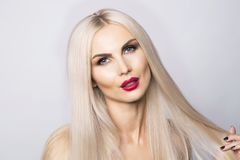 Beautiful blonde woman with red lips. Portrait shot stock photo