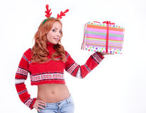 Beautiful blonde woman with reindeer antlers Stock Image