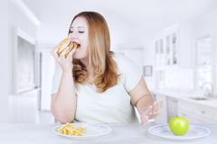 Beautiful blonde woman rejects apple fruit Royalty Free Stock Image