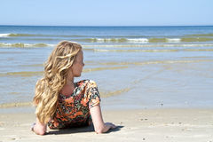 Beautiful blonde woman relaxing at the waterfront Stock Photo