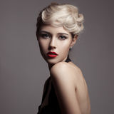 Beautiful Blonde Woman. Retro Fashion Image. Royalty Free Stock Image