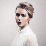 Beautiful Blonde Woman. Retro Fashion Image. Stock Image